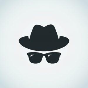 Investigator in hat and sunglasses